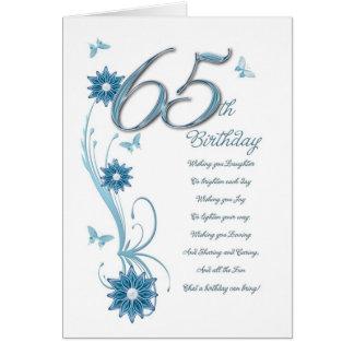 65ste verjaardag in wintertaling met bloemen en wenskaart