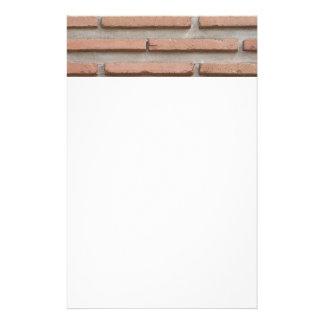 Bakstenen muur briefpapier papier