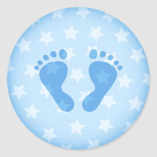 Blauwe babyvoetafdrukken op een sterrige ronde sticker