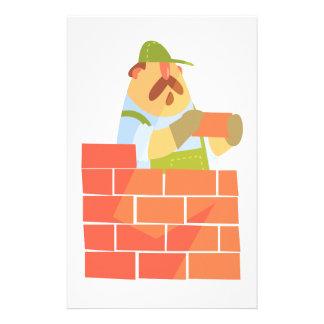 Bouwer die een Bakstenen muur op Bouwwerf leggen Briefpapier