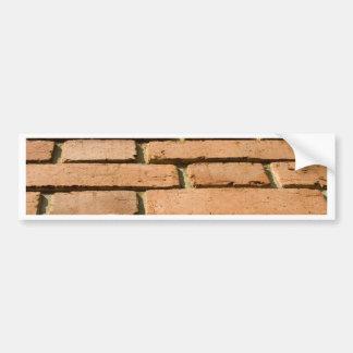 Close-up van een bakstenen muur bumpersticker