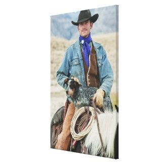 Cowboy en hond op paard canvas print