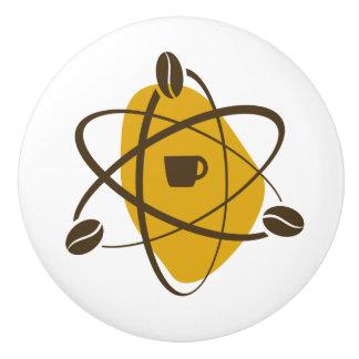 De atoom Bonen van de Koffie in Gouden Lade trekt Keramische Knop