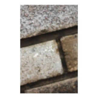 De baksteen legt achtergrond aangepast briefpapier