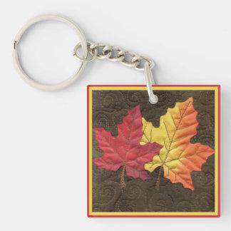 De Bladeren van de esdoorn in Herfst Sleutelhanger