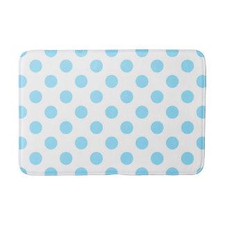 De blauwe en witte stippen van het baby badmat