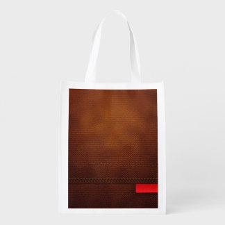 De bruine Oppervlakte van het Leer met Rood Label Boodschappentas