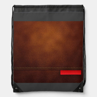 De bruine Oppervlakte van het Leer met Rood Label Gymtasjes