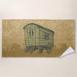 De caravanwagen van de zigeuner strandlaken
