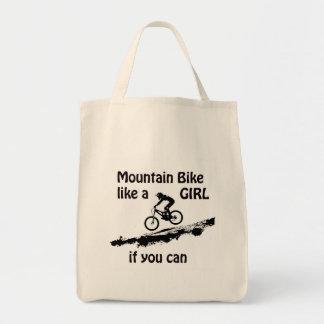 De fiets van de berg zoals een meisje draagtas