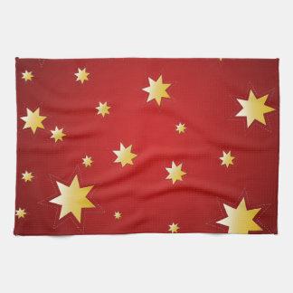 De fonkelende sterren van Kerstmis op rood Theedoek