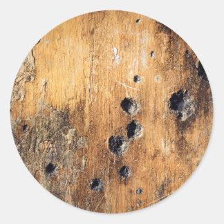 De gaten van de kogel in muur ronde sticker