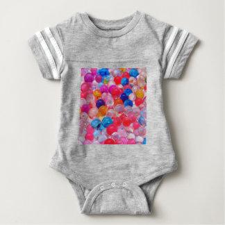 de gekleurde textuur van geleiballen baby bodysuit