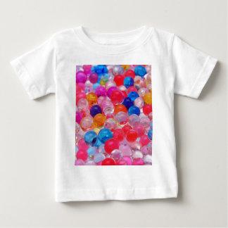de gekleurde textuur van geleiballen baby t shirts