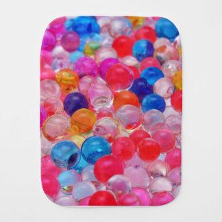 de gekleurde textuur van geleiballen spuugdoekje