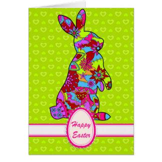 De gelukkige kaart van Pasen met konijn op groen