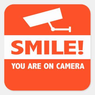 De glimlach u is op Camera Vierkant Stickers