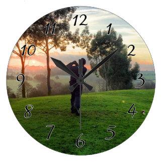 De Golfspeler van de zonsopgang Grote Klok