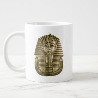De gouden JumboMok van Tut van de Koning Grote Koffiekop