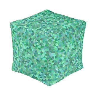 De groene driehoeken van de pastelkleur poef