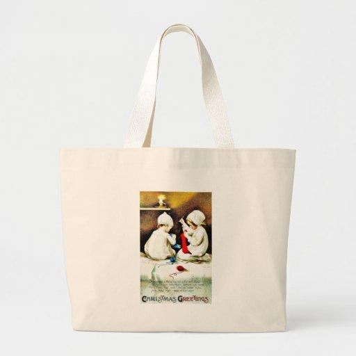De groet van Kerstmis met twee meisjes die schokke Tas