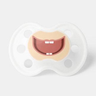 De grote glimlach van het baby op fopspeen