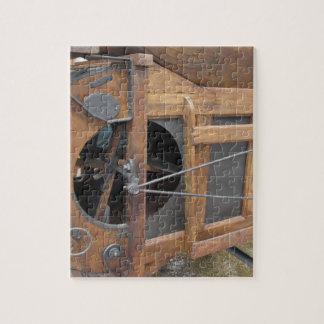De hand machine gebruikte om het graan te schillen foto puzzels