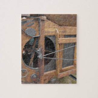 De hand machine gebruikte om het graan te schillen puzzel