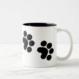 de koffiemok van de pootdruk