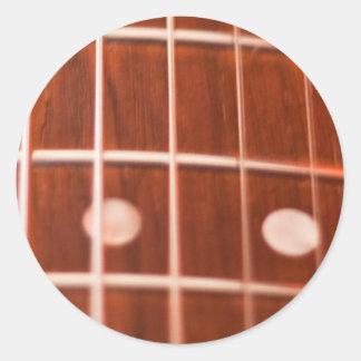 De koorden van de gitaar ronde sticker