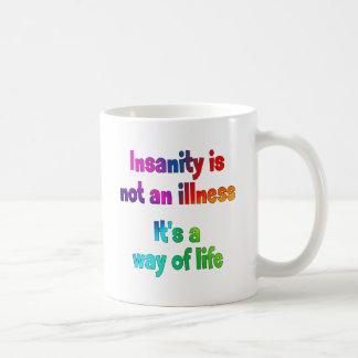 De krankzinnigheid is geen ziekte koffiemok