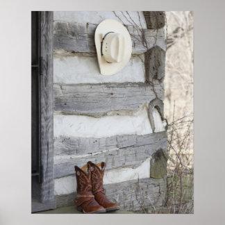 De laarzen en het pet van de cowboy buiten poster