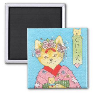 De magneet van Inu van Kokeshi