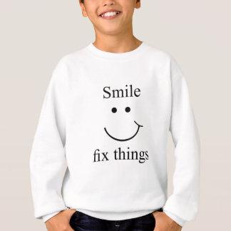 De moeilijke situatiedingen van de glimlach trui