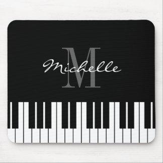 De muisstootkussen met monogram van pianosleutels muismat