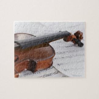 De muziek van de viool en van het blad legpuzzel