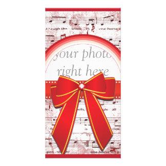 De muzieknota van Kerstmis met de rode kaart van