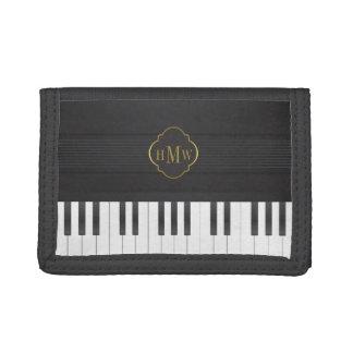 De pianogoud van het monogram