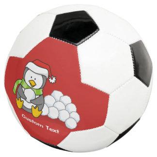 De pinguïnzitting van Kerstmis met sneeuwballen