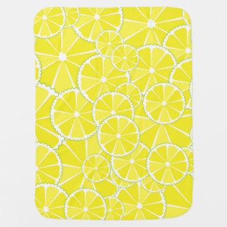 De plakken van de citroen inbakerdoek