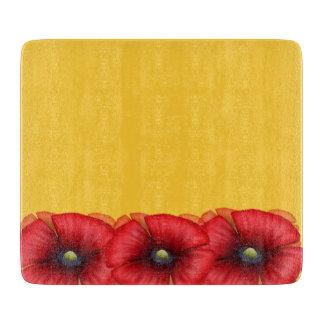 De rode cluster van de Papaver op het gele Hakbord Snijplank
