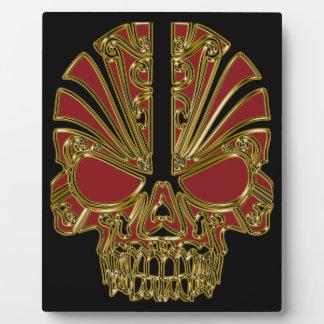 De rode en gouden schedel van de suikerschedel fotoplaat