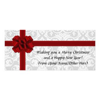 De rode Gestempelde Vakantie Kerstmis van het Lint Reclamekaart