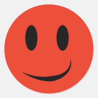 De rode sticker van het smileygezicht