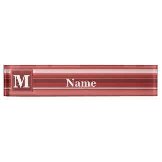 De rode strepen van het monogram