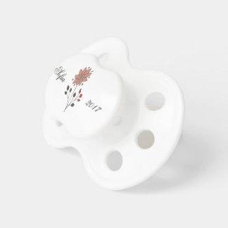 De roze bloem van het krabbelmadeliefje baby speentjes