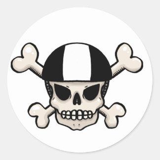 De schedel en de gekruiste knekels van de ronde sticker