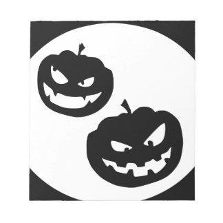 De silhouetten van de pompoen kladblokken