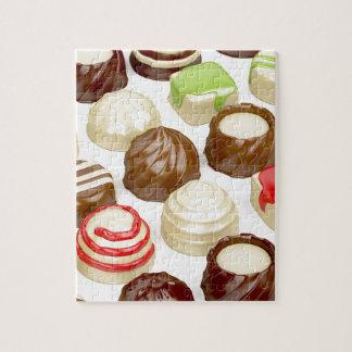 De snoepjes van de chocolade legpuzzel