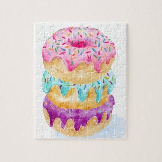 De stapel van de waterverf donuts legpuzzel